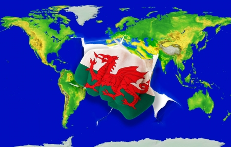 powerfull: Fist in color national flag of wales punching world map as symbol of export, economic growth, power and success Stock Photo