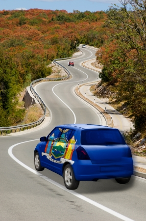 traveling car in flag of us state of new york colors and beautiful road landscape for tourism and touristic adertising photo