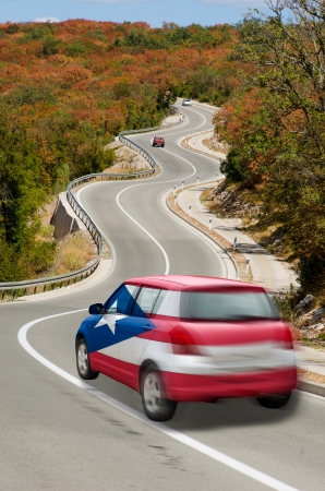 puertorico: traveling car in national flag of puertorico colors and beautiful road landscape for tourism and touristic adertising