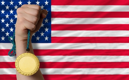 silver medal: Winner holding gold medal for sport and national flag of us Stock Photo