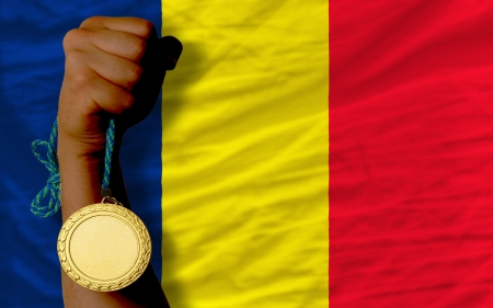 chadian: Winner holding gold medal for sport and national flag of  chad