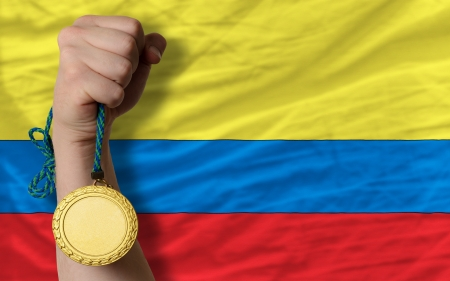medalist: Winner holding gold medal for sport and national flag of columbia