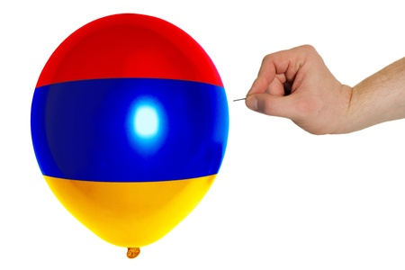 exploding balloon colored in national flag of armenia photo