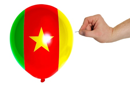 exploding balloon colored in national flag of cameroon photo
