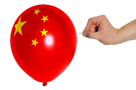 exploding balloon colored in national flag of china photo