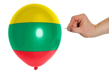 exploding balloon colored in national flag of lithuania photo