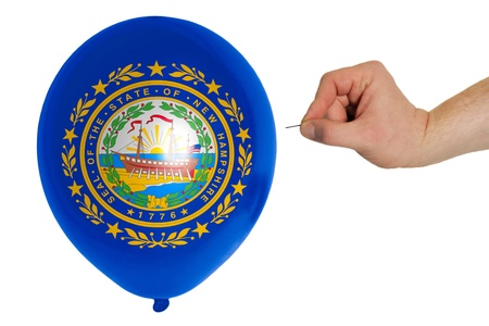 exploding balloon colored in flag of us state of new hampshire photo