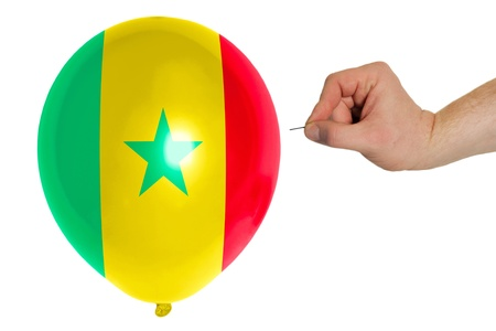 exploding balloon colored in national flag of senegal photo
