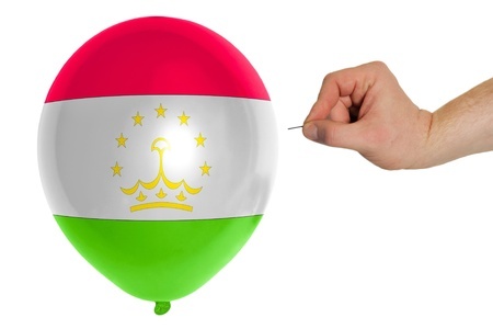 exploding balloon colored in national flag of tajikistan photo