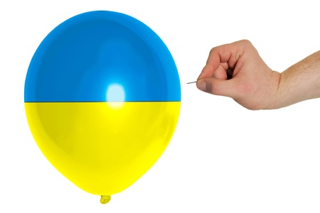 exploding balloon colored in national flag of ukraine photo