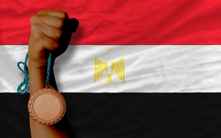 medalist: Holding bronze medal for sport and national flag of egypt