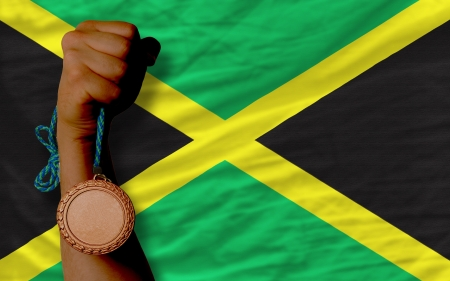 Holding bronze medal for sport and national flag of jamaica Stock Photo - 20567154