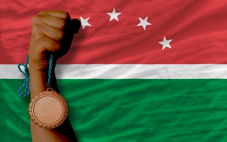 Holding bronze medal for sport and national flag of  maghreb Stock Photo