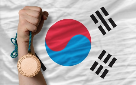 silver state: Holding bronze medal for sport and national flag of south korea