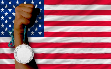 silver medal: Holding silver medal for sport and national flag of us