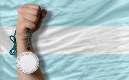 Holding silver medal for sport and national flag of argentina photo