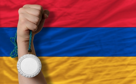 Holding silver medal for sport and national flag of armenia photo