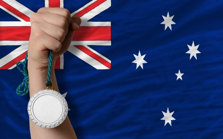 Holding silver medal for sport and national flag of australia photo