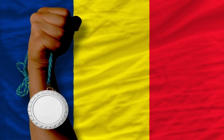 chadian: Holding silver medal for sport and national flag of  chad Stock Photo