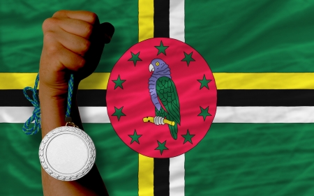 medalist: Holding silver medal for sport and national flag of dominica