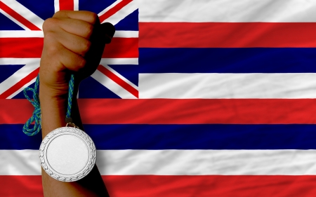Holding silver medal for sport and flag of us state of hawaii