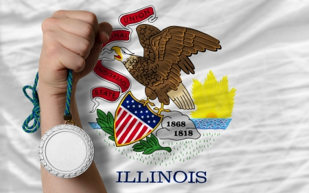 silver state: Holding silver medal for sport and flag of us state of illinois Stock Photo