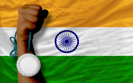medalist: Holding silver medal for sport and national flag of  india