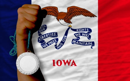 Holding silver medal for sport and flag of us state of iowa