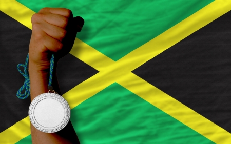 Holding silver medal for sport and national flag of jamaica Stock Photo - 20746249