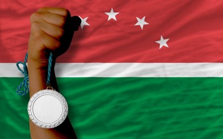 Holding silver medal for sport and national flag of  maghreb photo