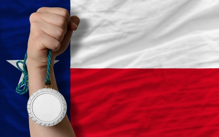 Holding silver medal for sport and flag of us state of texas Stock Photo
