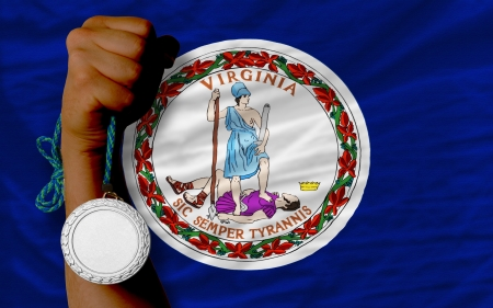 medalist: Holding silver medal for sport and flag of us state of virginia