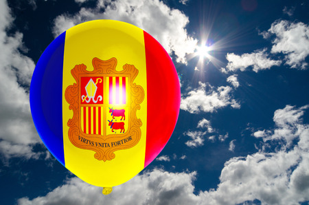 nationalistic: balloon in colors of andorra flag flying on blue sky Stock Photo