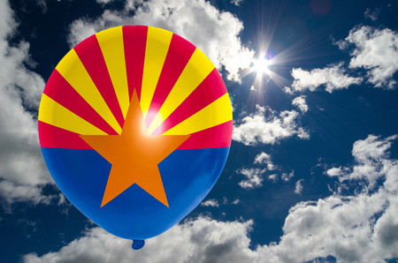 nationalistic: balloon in colors of arizona flag flying on blue sky