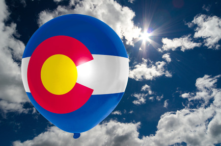 colorado flag: balloon in colors of colorado flag flying on blue sky Stock Photo