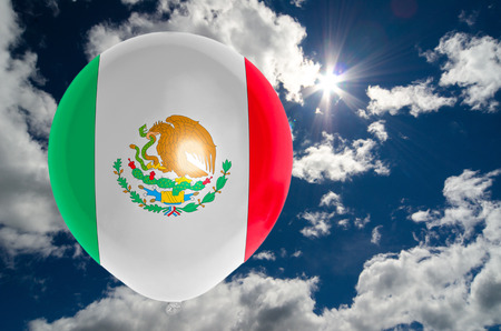 nationalistic: balloon in colors of mexico flag flying on blue sky Stock Photo