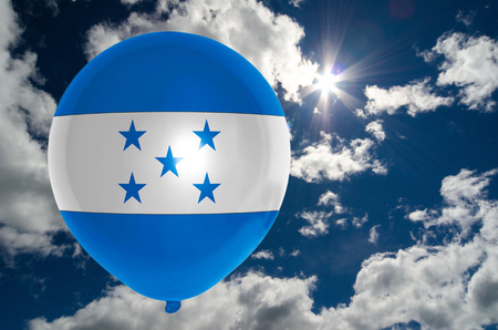 nationalistic: balloon in colors of honduras flag flying on blue sky Stock Photo