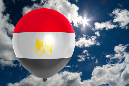nationalistic: balloon in colors of egypt flag flying on blue sky