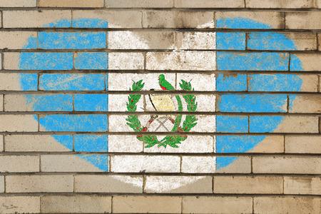 guatemalan: heart shaped flag in colors of guatemala on brick wall