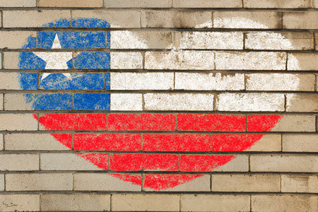 chilean: heart shaped flag in colors of chile on brick wall