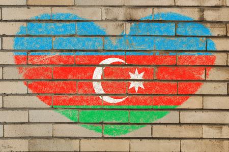 heart shaped flag in colors of azerbaijan on brick wall photo