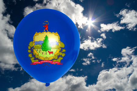 nationalistic: balloon in colors of vermont flag flying on blue sky Stock Photo