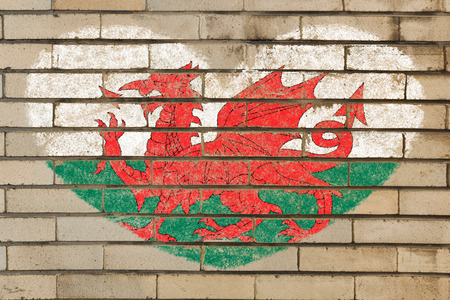 wales: heart shaped flag in colors of wales on brick wall Stock Photo