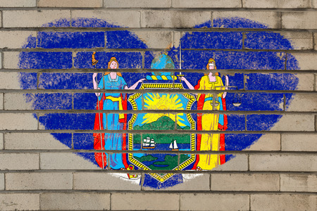 old new york: heart shaped flag in colors of new york on brick wall Stock Photo