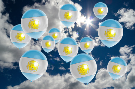 nationalistic: many ballons in colors of argentina flag flying on sky