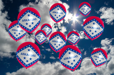 nationalistic: many ballons in colors of arkansas flag flying on sky Stock Photo