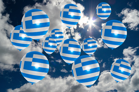 nationalistic: many ballons in colors of greece flag flying on sky