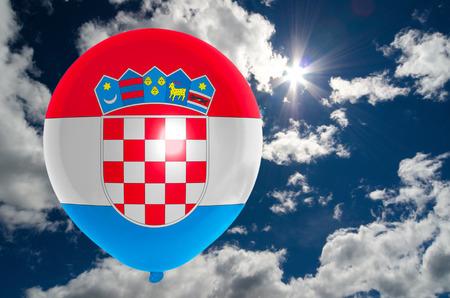 croatia flag: balloon in colors of croatia flag flying on blue sky Stock Photo