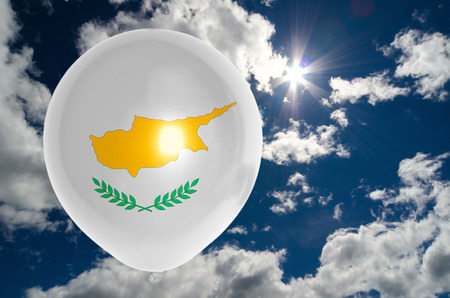 nationalistic: balloon in colors of cyprus flag flying on blue sky Stock Photo