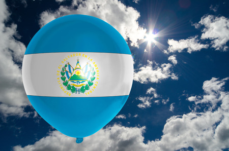 nationalistic: balloon in colors of el salvador flag flying on blue sky Stock Photo